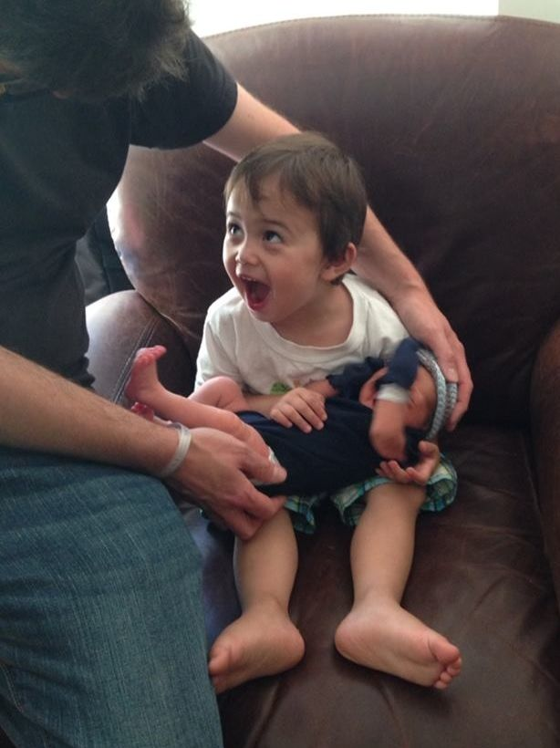 Grandson holding his brother